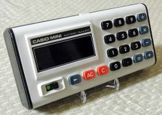 Vintage Casio Mini Electronic Pocket Calculator, Model CM-605, 6 Digit Bue VFD, Made in Japan, Circa 1974.