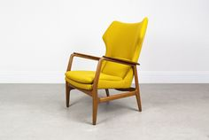 Aksel Bender Madsen Wing Chair, c1960 Produced by Bovenkamp, Holland. Oak frame with teak armrest. Reupholstered in yellow Kvadrat Hallingdal fabric.