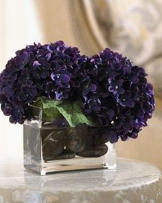Purple Hydrangea Arrangement - These are great with an led light hidden in them so when night falls they glow.  Very inexpensive but the color does vary; after all, they are a flower.