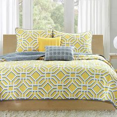 Refresh your master suite or guest room in classic style with this lovely coverlet set, showcasing a geometric motif in gray and yellow.