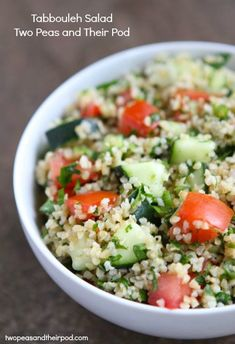 Tabbouleh Salad- an easy salad made with bulgur wheat, tomatoes, cucumbers, and herbs. Recipe from www.twopeasandtheirpod.com