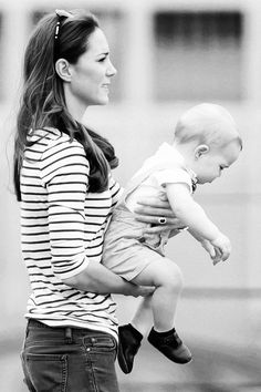 Kate Middleton and Prince George watch William play polo.