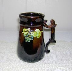 Vintage Peters & Reed Art Deco 1930s Pottery Standard Glaze Fancy Mug with Grape Clusters. Peters & Reed pottery is affiliated with Weller Pottery.