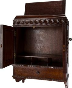 Furniture : English, A Diminutive Victorian Carved Oak Hanging Cabinet, late 19th-early20th century. 19-1/2 h x 14 w x 7 d inches (49.5 x 35.6 x...