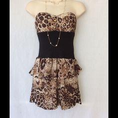 Cheetah Dress With Clear Straps This beautiful cheetah print dress does not have the tags measurements are chest 13 waist 11 length 23. There also is clear straps new in a bag to go with this dress?Sorry no trades. Dresses Mini