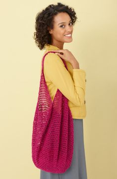 Sparkling with color, this crocheted bag is the perfect take-along for holiday shopping and visiting with out of town friends.