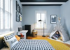Pattern and color transform an office into a toddler's room. Photo by Corey Gaffer, interior by @dezaarinteriors