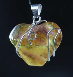 Beautiful genuine good quality Amber with silver wire wrap.This is handmade unique item,you get what is on the picture.Free gift box included. Settings:                    ...