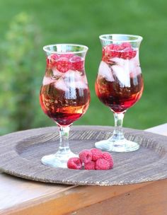 Cowgirl Raspberry Sparkler-  1 oz. raspberry vodka  1/2 oz. Chambord  7-up or Sprite  Fresh raspberries    Into a cocktail glass filled with ice add the vodka and Chambord, fill with 7-up and top with raspberries.