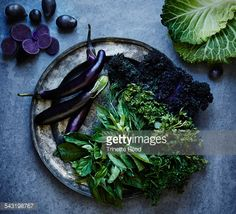 Stock Photo : High angle view of herbs and vegetables on metal plate