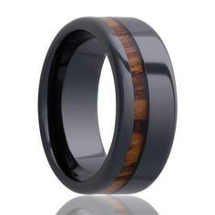 An offset inlay of striped Zebra wood, makes a stunning accent in CEBRA's black ceramic band. A noticeable in width, this made to order ring has a Comfort Fit band. Pictured in FINISH: Polished WALL THICKNESS: BAND: Comfort Fit METAL Wedding Ring Finger, Wedding Ring Bands, Black Wedding Rings, Black Rings, Wood Inlay Wedding Band, Wood Inlay Rings, Wedding Men, Black Diamond, Rings For Men