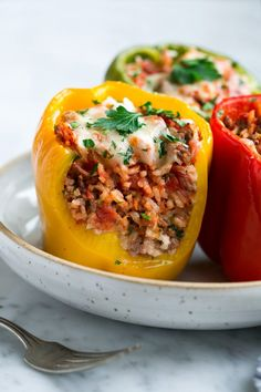 The best stuffed peppers! Fresh peppers stuffed with seasoned beef, rice and tomato filling and baked until perfectly tender. Finished with cheese and sure to satisfy! And no pre-boiling peppers here! Best Stuffed Pepper Recipe, Vegan Stuffed Peppers, Mexican Stuffed Peppers, Recipe For Stuffed Peppers With Rice, Bell Pepper Stuffed, Filled Peppers Recipe, Stuff Peppers Recipe, Ground Chicken Stuffed Peppers, Stuffed Bell Peppers Turkey