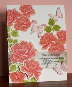 I love the mixture of the roses, butterflies, and the vellum for the sentiment