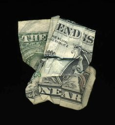 A series of folded money prints spelling different phrases by New Orleans artist Dan Tague