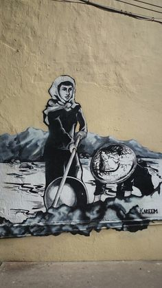 Mural art of ladies are picking tin mines using traditional method