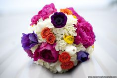 bridal bouquet: orange spray roses, substitute purple for the pink