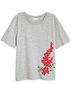 H&M Embroidered T-Shirt | Pretty, embroidered details have been popping up everywhere all season long—super-soft viscose tees are no exception. Also available in white and stripes.