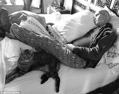 Patrick Swayze resting with his cat in the final stages of his battle with cancer. Released by his wife after his death.