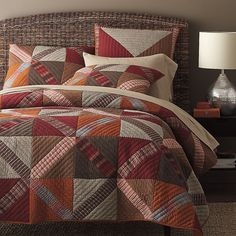 The Stratton patchwork quick celebrates fall's rich earth tones in a graphic mix of yarn-dyed solids and stripes. Quilted by hand.
