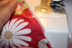 Several of you mentioned that my serger gathering tutorial was helpful so I thought I'd post a how to for rolled hems. This one is a bit tr...
