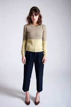 Tailored wool pant with front lining to the knee. Features front pleats and zip fly fastening with hook & bar.   * high waisted * cropped length * tapered fit * 60% wool, 40% viscose composition