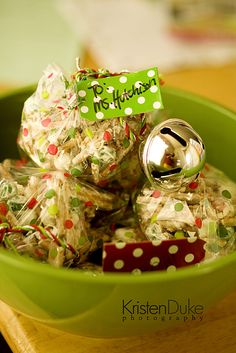 Christmas crunch. 2 bags mint m&m's,1 package while almond bark, 1 bag stick pretzels. melt chocolate, mix in the snacks, spread on paper/pan and let harden. Separate and bag.