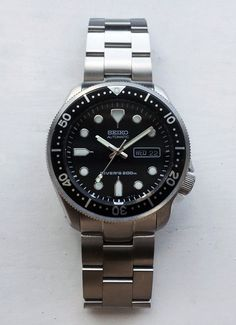 SKX171 w/ 6109 hands, coin bezel, and 007 insert