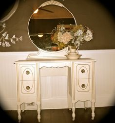 I could just picture myself rolling up my victory rolls and applying a bit of rouge on my lips in front of this beautiful vanity.  Antique Dressing Table  Vintage Vanity  Shabby by NookandCrannyCo, $300.00