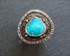 ForestBook via Etsy.  Rustic sleeping beauty turquoise ring in mixed metal.