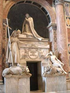 The monumental tomb of Clement XIII is by Antonio Canova, who worked on it from 1783 to 1792. It shows the pope kneeling in prayer with the tiara beside him, and to the left of the sarcophagus