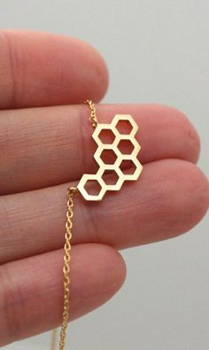 Honeycomb necklace | Beehive necklace - more great angles in a gold tone - but a little small and precious and maybe too cute - would have to see how it looks with an entire outfit.