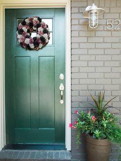 DIY Fall Inspired Pom-Pom Wreath | HGTV >> http://www.hgtv.com/design/make-and-celebrate/handmade/make-a-fall-inspired-pom-pom-wreath?soc=pinterest