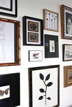 Gallery wall with black and gold frames. (i especially like the one frame with mostly white and that strong graphic branch image. Gallery Wall Frames, Gallery Walls, Collage Frames, Art Gallery, Deco Boheme, Decoration Design, New Wall, Home Decor Inspiration, Picture Wall