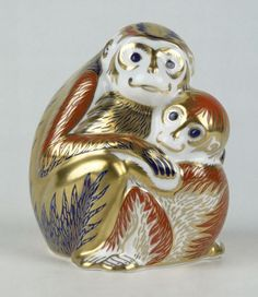 Royal Crown Derby ~ Porcelain figural mom monkey and baby ~ Aprox. 4 1/2 inches long