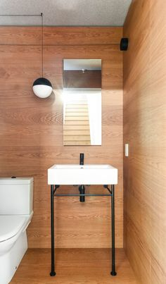Interior Design by Falken Reynolds - Vancouver loft powder room with medium stained white oak floor and walls with Flos string pendant, photo by Ema Peter