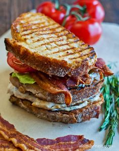 A delicious club sandwich made with grilled chicken,bacon, lettuce,tomato, and a rosemary aioli.