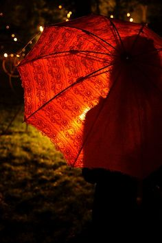 THERE IS NOTHING SO FINE AS AN UMBRELLA TO FEND OFF THE RAIN…….OH!  THE REDDER -- THE BETTER………….ccp