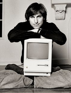 Steve Jobs with the first Macintosh