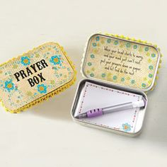 """Prayer Box The power of prayer. """"When your head starts to worry and your mind just can't rest, put your prayers down on paper and let God do the rest."""" Paper and pen included. Tin/paper/plastic. 3.75""""l x 2.5""""w x 1""""d."""