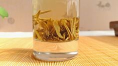 """Our jasmine """"Dragon Pearl"""" green tea is a deliciously sweet green tea that combines the absolute highest quality tea with a sweet jasmine aroma and taste.  Completely hand crafted into small pearls, this tea is amazing to drink and watch as it brews."""