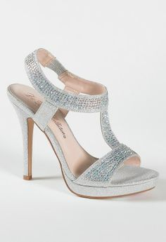 "High heel sparkle sandal features:• 4.25"" heel• 1"" platform • Elastic ankle strap• Padded insole• Medium width only"