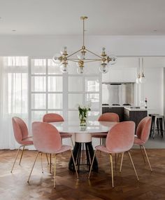bcc0bd13869 mid century modern glam dining room    pink dining room chairs    gold and