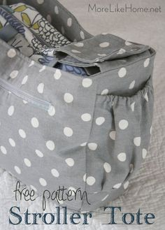 Make your own Stroller Tote with this free pattern & tutorial! It attaches to most standard strollers in seconds to keep your hands free when you're on the move!