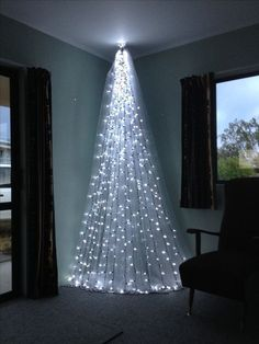 Top 6 Alternative Christmas Tree Ideas - DIAMOND INTERIORS - - Short on space? Try these stunning alternative Christmas tree ideas to WOW this Christmas! Different Christmas Trees, Wall Christmas Tree, Creative Christmas Trees, Diy Christmas Lights, Decorating With Christmas Lights, Beautiful Christmas Trees, Modern Christmas, Christmas Holidays, Christmas Tree Ideas For Small Spaces