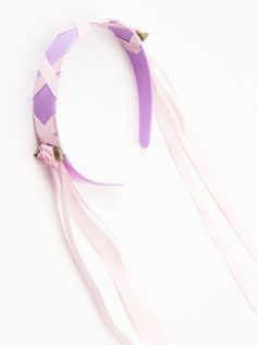 Rapunzel isn't complete without her signature lavender headband! This quality headband coordinates perfectly with our many Rapunzel dress ups. It's wrapped in purple satin and has pink ribbon in a wov