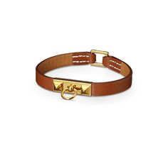"Micro Rivale Hermes micro leather bracelet (size M) Natural tadelakt calfskin<br /><br />Gold plated hardware, 2.5"" diameter, 7"" circumference.<br />"