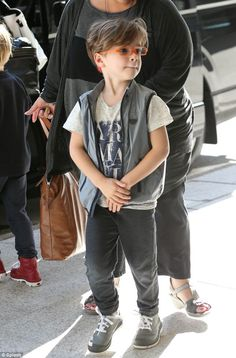 What a cutie: Little Valentino wore his signature glasses under his playfully messy hair...