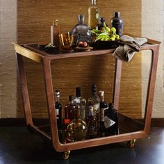 This Walnut Bar Cart by Roost is available online at Houzz.com