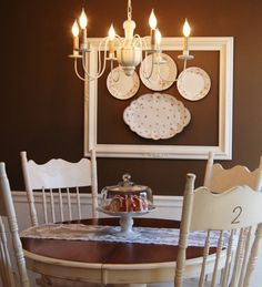 Unique wall display using a large, empty frame, and hanging decorative plates within. Fabulous idea!