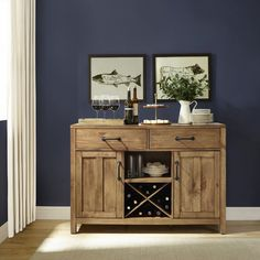 Hand-finished, this solid hardwood sideboard showcases natural warmth through authentic wood detailing, paneled doors, and metal hardware. Two drawers, two cupboards, and a middle shelf offer versatile storage.
